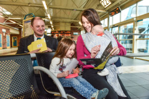Arriva driver Kenneth Griffiths handing Hallmark cards to BobbieLoughlan and her little girl Chloe (3)